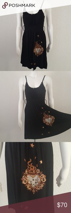"""Soul Revival Hippie BoHo Goth Black Dress S How fun is this? Black soft knit dress from Soul Revival in a size small. Adjustable straps. Fitted under chest then a flowing bottom half. Intricate, thick celestial boho embroidery on front left. Alternating studs at neckline. Stretchy, soft and super comfortable! Chest 15"""" across front underarm to underarm. Length 36"""" top of shoulder strap to hem. Soul Revival Dresses Midi"""