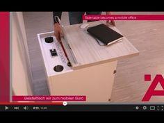 Interzum 2015 : plus de vie au m2 ! >> La table d'appoint devient un bureau mobile : le dessus du meuble comporte un rail porte-tablette, il coulisse pour révéler prise électrique et connecteurs USB, les portes s'ouvrent à 180° grâce aux charnières Aximat 300 SM, le fond intérieur du meuble coulisse pour avancer l'imprimante et permettre son utilisation, un enrouleur de câble d'alimentation avec cache est dissimulé dans la paroi.