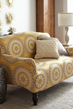 The bright Suzani pattern on Pier 1's hand-upholstered Frankie Loveseat will make your living room spring central.