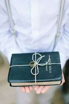 Bible as #ringpillow - photo by http://www.whenhefoundher.com/ - view more http://ruffledblog.com/brooklands-farm-wedding/