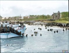 The view looking east along 'Nan White' Beach, JUNO Area at Bernières-sur-Mer, showing personnel of the Stormont, Dundas & Glengarry Highlanders (SD&G Highr), 9th Canadian Infantry Brigade, 3rd Canadian Infantry Division, landing from LCI(L) 299 of the 2nd Canadian (262nd RN) Flotilla on D-Day 6 June 1944