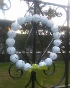 A Golf Ball Christmas Wreath Our Residential Golf Lessons are for beginners, Intermediate & advanced. Our PGA professionals teach all our courses in an incredibly easy way to learn and offer lasting results at Golf School GB www.residentialgolflessons.com