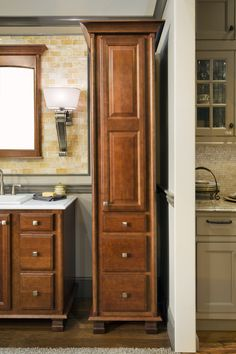 Explore Wellborn Cabinets Elegant Bath Collection which includes vanities and linen cabinets medicine cabinets and mirrors in a variety of design styles. Wellborn Cabinets, Rose Hall, Bathroom Vanity Cabinets, Baths, Tall Cabinet Storage, Cherry, It Is Finished, Elegant, Furniture