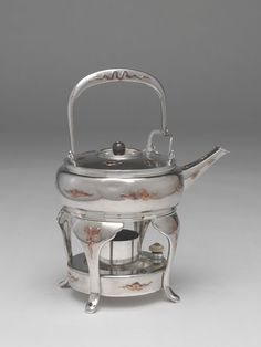 Tiffany and Company American, founded 1837 Possibly designed by Edward C. Moore American, 1827-1891 New York, New York Teakettle and Stand, Tea kettle, 1877; stand, 1889
