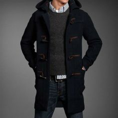 Shop this look for $181:  http://lookastic.com/men/looks/duffle-coat-and-crew-neck-sweater-and-belt-and-jeans-and-longsleeve-shirt/468  — Navy Duffle Coat  — Charcoal Crew-neck Sweater  — Black Leather Belt  — Blue Jeans  — White and Navy Vertical Striped Longsleeve Shirt