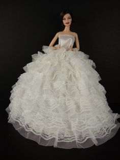 Beautiful White Gown with Tons of Ruffles Ball Gown Made to Fit the Barbie Doll Olivia's Doll Closet,http://www.amazon.com/dp/B0029LF7Y2/ref=cm_sw_r_pi_dp_tFgstb19XQV1C1HB