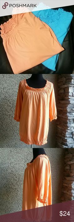 Woman's Lane Bryant Blouses Lot of 2 Sz 22/24 Woman's Lane Bryant Blouses lot of 2. Sz 22/24 Good condition. Some color fade with Orange top and a tiny pin hole on the bottom front as seen in pic. Shirts have ruffle like design at top and the stretch band design on the bottom. Lane Bryant Tops Blouses