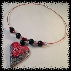 Handmade Jewellery - Necklace £9.95. A gift idea by Patrice found on www.MyOwnCreation.co.uk: Individually hand made heart made from black, red, silver textured polymer clay strung on a red memory wire necklace. Size approx 18 inch.Free  postage and packaging to the UK