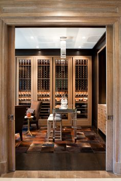 Interior designer Brian Gluckstein created a chic wine cellar for a Toronto client, which features custom leather-clad wood shelving, cowhide flooring and vintage Baccarat accessories. The wine cellar is off the master hallway and showcases a Baccarat desk with vintage decanters, John Saladino stools and a wet bar for cocktails.