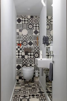 The small powder room features graphic ceramic tile from Couleurs & Matures Patc. - The small powder room features graphic ceramic tile from Couleurs & Matures Patchwork. A Parisian Pied-À-Terre by Piret Johanson Studio Small Bathroom Wallpaper, Bathroom Design Small, Bathroom Interior Design, Ideas Baños, Decor Ideas, Beautiful Small Bathrooms, Small Toilet Room, Guest Toilet, Powder Room Design