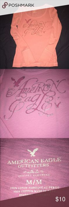 American Eagle long sleeve pink tee size Medium AEO long sleeve fitted tee. Pink with darker pink writing. Has silver outline on the pink writing, also. Size Medium. Only wore a few times. Great condition! American Eagle Outfitters Tops Tees - Long Sleeve