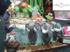 The Jungle Book - Elephants made from fondant  Bottom tier of my Jungle Book Cake on show at the Cake & Bake Show London 2015