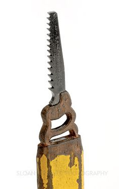Hand Saw. Amazing miniature sculpture made by Mr. Ghetti in Connecticut.