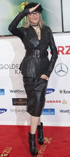 Diane Keaton.....ugly boots,it looks awful with the suit