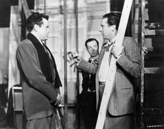 Orson Welles receives direction from Carol Reed on the set of The Third Man, 1949.