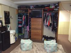 Dorm room- Burge at University of Iowa!! Closets with stacked dressers and tv