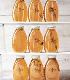 Transform store-bought honey with an aromatic sprig and our sweet bee art. (Formatted to fit an 8½''W x 11''L sheet of sticker paper) Recipe: Rosemary Honey (Jars, $13.44 for 12; 16 oz.; sks-bottle.com. Blank clear stickers, $7.95 for three sheets; worldlabel.com.)