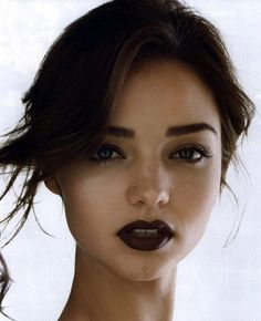 pale skin, dark lips •