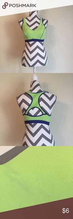 Blue and Green Sports Bra Women's 38D. Padded. Has minor discoloration and pilling. 90% nylon, 10% Lycra. 89% nylon, 3% shiny nylon 2.3 oz Danskin Intimates & Sleepwear Bras