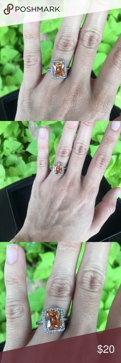 Citrine colored fake engagement ring sz 6 Silver band citrine colored halo fake diamond ring. Size 6. Looks stunning and legit. Great cocktail ring or fake engagement ring. Sparkles beautifully in the light. 💍 always open to offers. 😊 Jewelry Rings