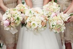 The bridesmaid's bouquets seem a bit messier than the bride's but those dresses look pretty with these colours of flowers