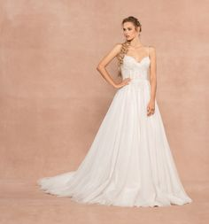 Style 62001 Starlie Hayley Paige bridal gown - Ivory sparkle tulle A-line gown, spaghetti strap corset bodice stardusted with florettes and micro rhinestones, flowing A-line skirt over cashmere lining.
