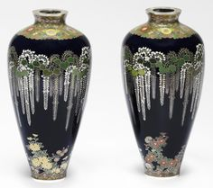 An important and fine pair of matching cloisonné-enamel ovoid vases By Namikawa Yasuyuki (1845-1927), circa 1897 Delicately worked in silver wire of varying gauge with an identical design.Each vase 16.8cm x 7.5cm (6 5/8in x 3in). (4). Sold for £68,500 at Bonhams, 2015