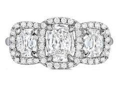 Check out this gorgeous Henri Daussi pave halo diamond engagement ring, available in your choice of metals!