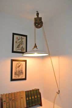 Same artisan - love the look of them.    Industrial/Vintage Pulley Hanging Pendant Light with Porcelain Enameled Shade on Etsy, $138.00
