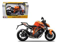 KTM 1290 Super Duke R Orange Motorcycle Model 1/12 by Maisto - Wheels roll and steer. Made of die cast metal with some plastic parts. Approximate Dimensions: L-7, H-4.25, W-1.75 Inches. Please note that manufacturer may change packing box at anytime. Product will stay exactly the same.-Weight: 1. Height: 5. Width: 9. Box Weight: 1. Box Width: 9. Box Height: 5. Box Depth: 5