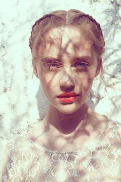 Chloe- you can see the detail of the branches against her face and the lightness of her hair against her skin.