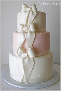 Lovely bows on a dotted white and pink wedding cake #weddingcake #cake #bows #polkadot #pinkwedding
