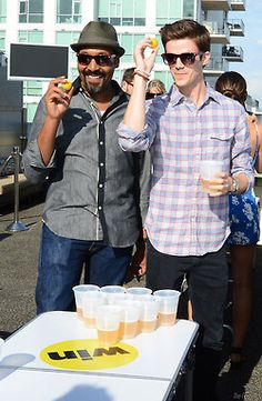 Jesse L. Martin and Grant Gustin attend The Flash Bash with BuzzFeed & The CW at the Marriott Gaslamp Quarter on Friday July 26, 2014 in San Diego.