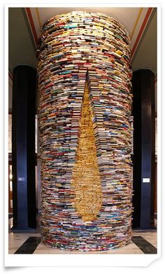 Idiom (1994) by Matej Krén (http://www.matejkren.cz/en). First exhibited at the São Paulo International Biennial. This photo (taken by Jan Sedláček) is from the Prague municipal library, where the tower of books was permanently installed in 1998. See an interior view of the tower here: http://pinterest.com/pin/366973069606089081/  [ #books #library #sculpture ]