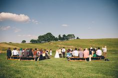 adorable outdoor wedding ceremony in a field | Abby & Logan's thrifted, DIY Adventure themed Virginia barn wedding | Images: An Endless Pursuit