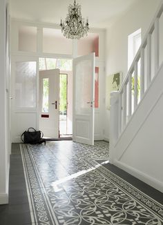 I love everything about this hallway! The tiles, the light, the glass door/wall, the stairs... everything