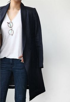 """Classics: White tee and denim with a black/navy coat slung over the shoulders in an """"editor-chic"""" fashion"""