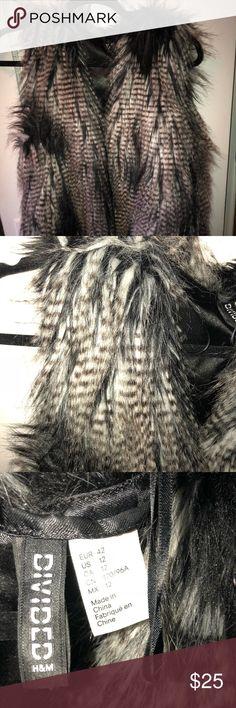 H&M black and white feather vest size 12 H&M feather vest size 12 (fits like M/L) H&M Jackets & Coats Vests