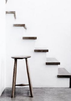 simplicity-This is a simple space because the walls are a pure white, and there is no detailed work to the stairs or stool.