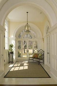 archways, white walls, lantern.