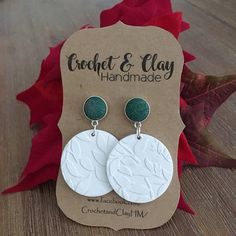 A gorgeous set of white embossed discs featuring green glittered fabric studs <3 They are lovely and lightweight and just beautiful to wear!! Made from hypo allergenic surgical steel, gold foil and polymer clay. 12mm diameter studs with a length of 50mm.