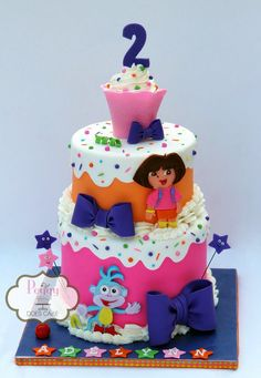 Dora cake - fondant over white chocolate ganache with fondant detail.