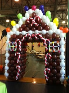 Gingerbread House balloon arch by Lisa Swiger of Blooming Balloons, Raleigh, NC