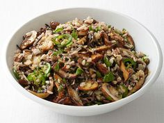Spicy Wild Rice with Mushrooms Recipe : Food Network Kitchen : Food Network Wild Rice Recipes, Vegetarian Recipes, Healthy Recipes, Rice Dishes, Mushroom Recipes, Side Dish Recipes, Food Network Recipes, Spicy, Stuffed Mushrooms