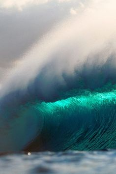 Crashing wave turquoise sea blue surf