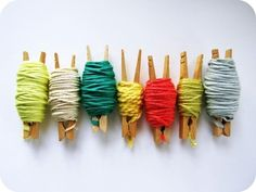 Store and display your yarn on clothespins. | 34 Adorable Things To Do With Leftover Bits Of Yarn