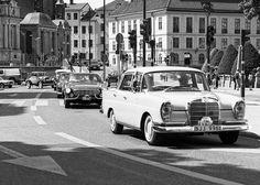 Nice caravan of old cars.