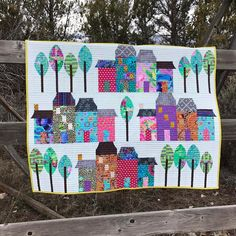 Our Urbanologie Houses and Trees - Dressed in #kaffefassett - LOVE!! #sewkindofwonderful #urbanologie #urbanologiehouses #urbanologietrees #qcrmini #gammill #quilting #quilts #sewkindofwonderfulsherilyn #quiltsofinstagram