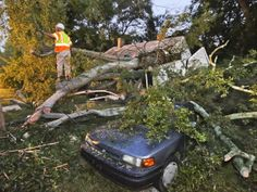 October 4, 2013 Atlanta : City of Atlanta workers removed parts of a tree that blocked Bernard St. after it crash into a house and parked ca...