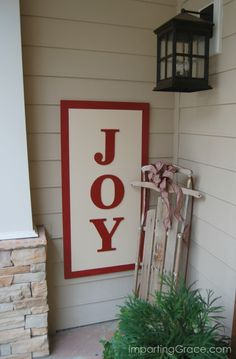 """Create your own decor this year with a DIY """"Joy"""" sign! Check out the tutorial on Imparting Grace. 